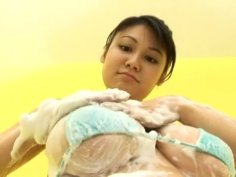 Busty oriental chick Hikari Asahi eating banana