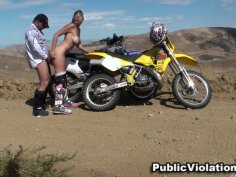 Biker girl blows and fucks her partner in the desert