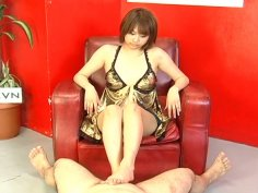 Short haired chick Reimi Fujikura provides a Japanese dude with a footjob